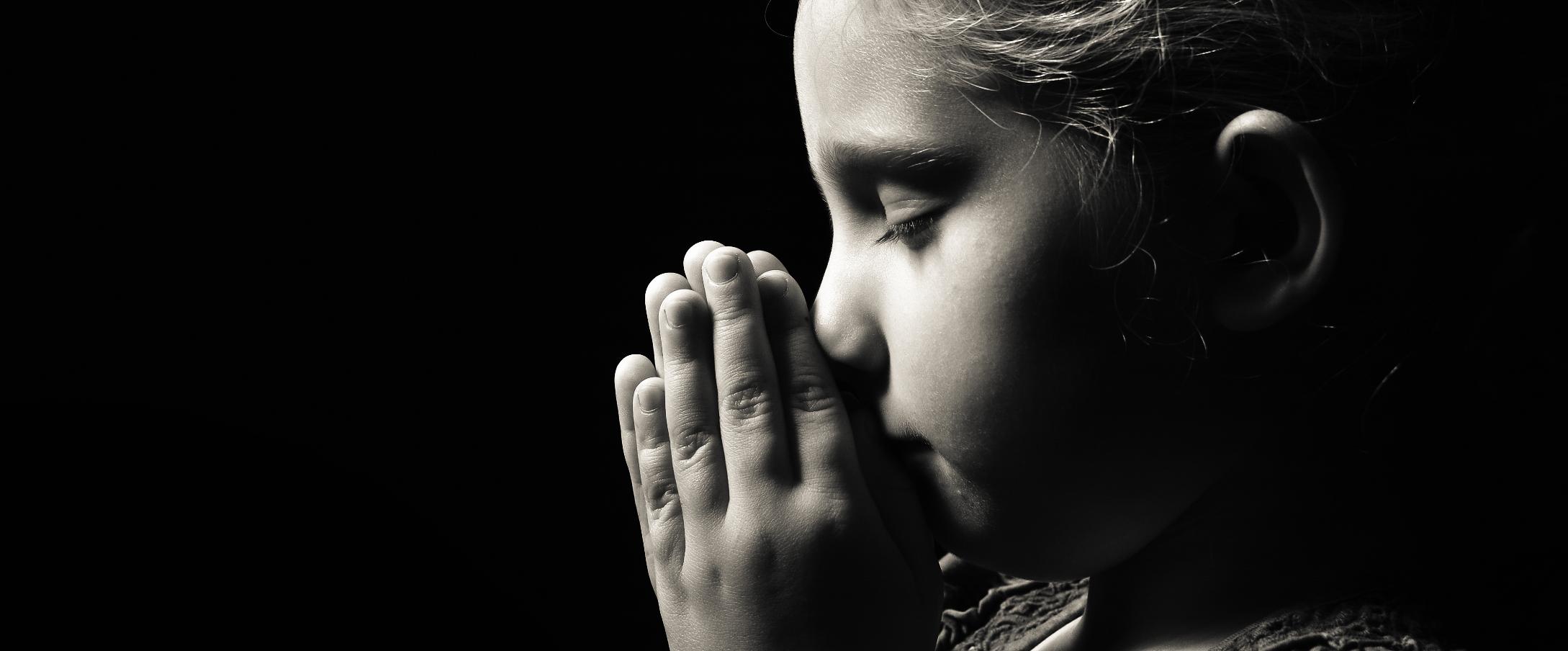 Muskegon Catholic Central student praying