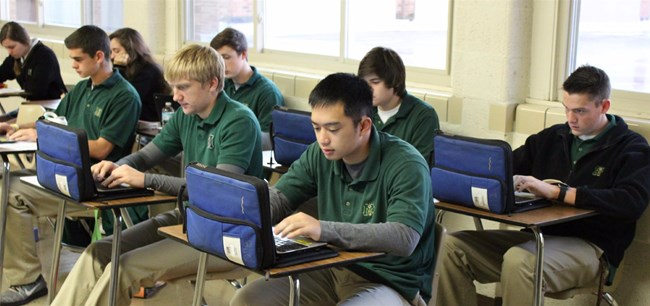 Classroom of Muskegon Catholic Central students using laptops