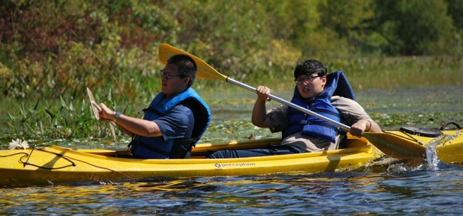 Muskegon Catholic Central students kayaking during a fall retreat