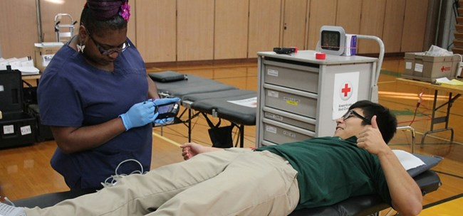 Muskegon Catholic Central student donating blood for service project